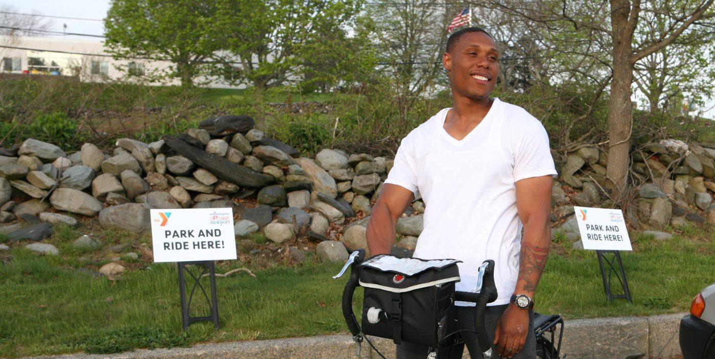 Man taking advantage of Bike Newport's Park & Bike at the Y
