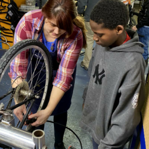 bike repair instructor and student